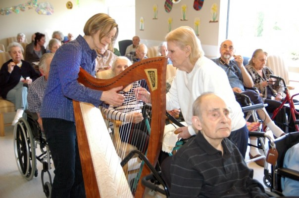 Harpist Alison Vardy at a Ptarmigan Taking Flight seniors' performance at James Bay Lodge.