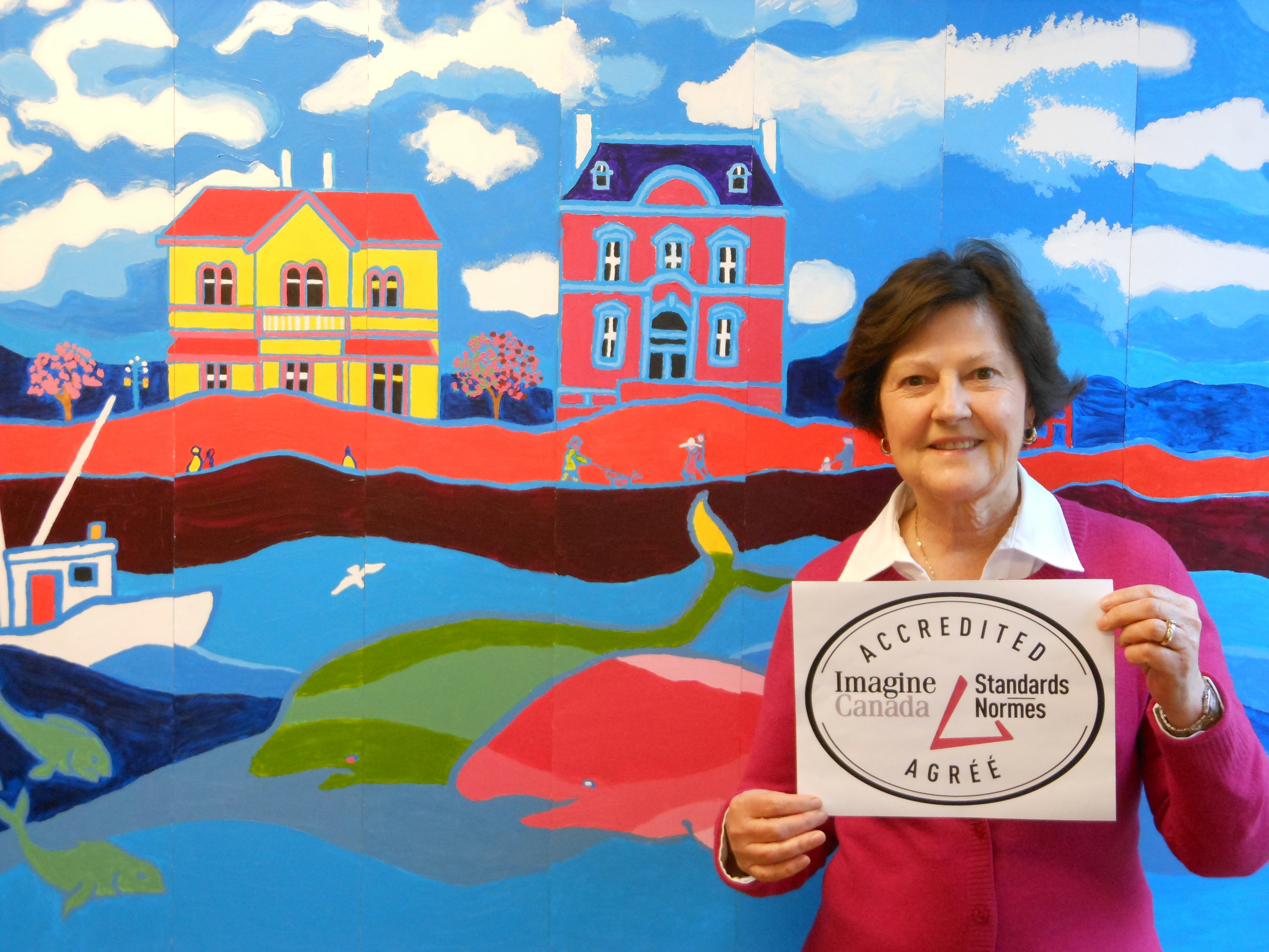 Victoria Foundation CEO, Sandra Richardson, showing accreditation recieved from Imagine Canada