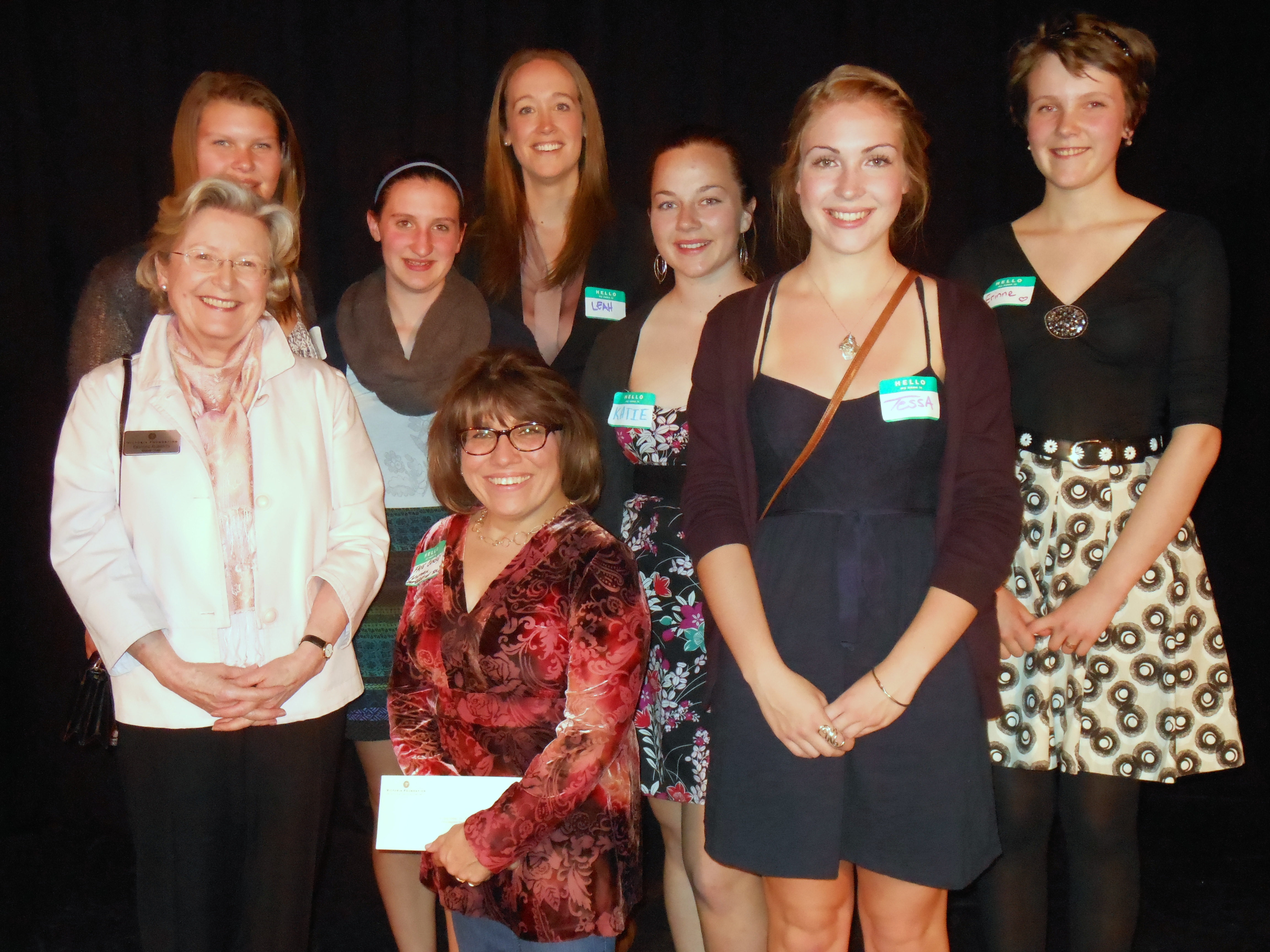 From left to right: Reynolds Secondary School Vital Youth representatives Kate Worthy, Sara McKinnon, Leah Baade, former Vital Youth Program Coordinator for the Victoria Foundation, students Katie Gamble, Tessa Fryer, Erinne Paisley. Front, left to right, Victoria Foundation Board Chair Deirdre Roberts and Faye Cawsey of Recreation Integration Victoria