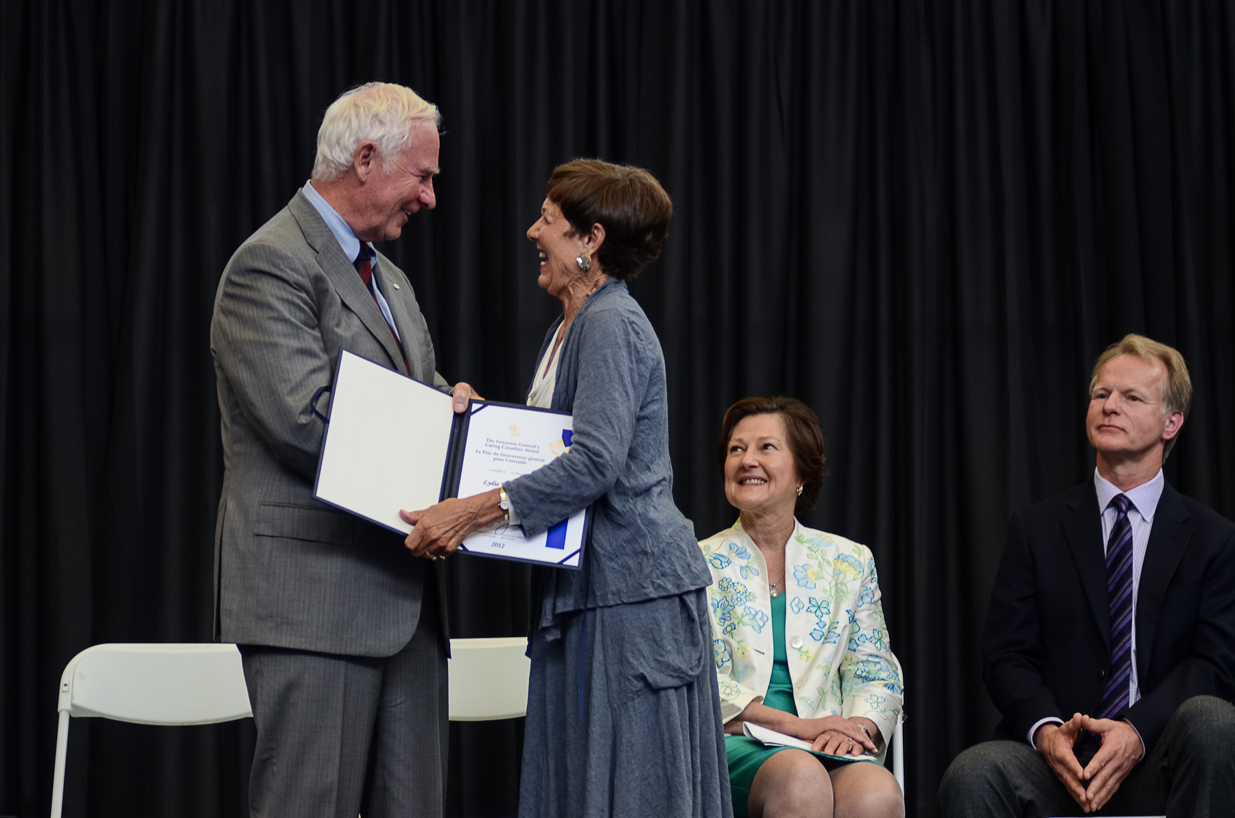 Lydia Kasianchuk, who includes volunteering as a community advisor  for the Victoria Foundation among her many volunteer roles, receives her Caring Canadian citation from His Excellency, The Right Honorable David Johnston. Sandra Richardson, CEO of the Victoria Foundation, is in the background