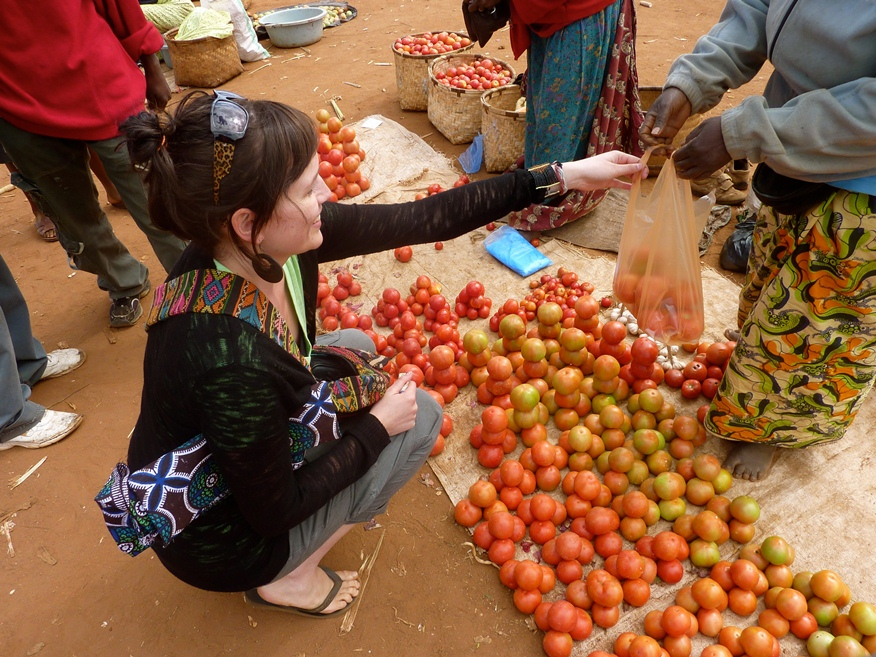 Buying tomatoes at the market in Dzaleka Refugee Camp.