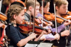 Children playing fiddles/violins